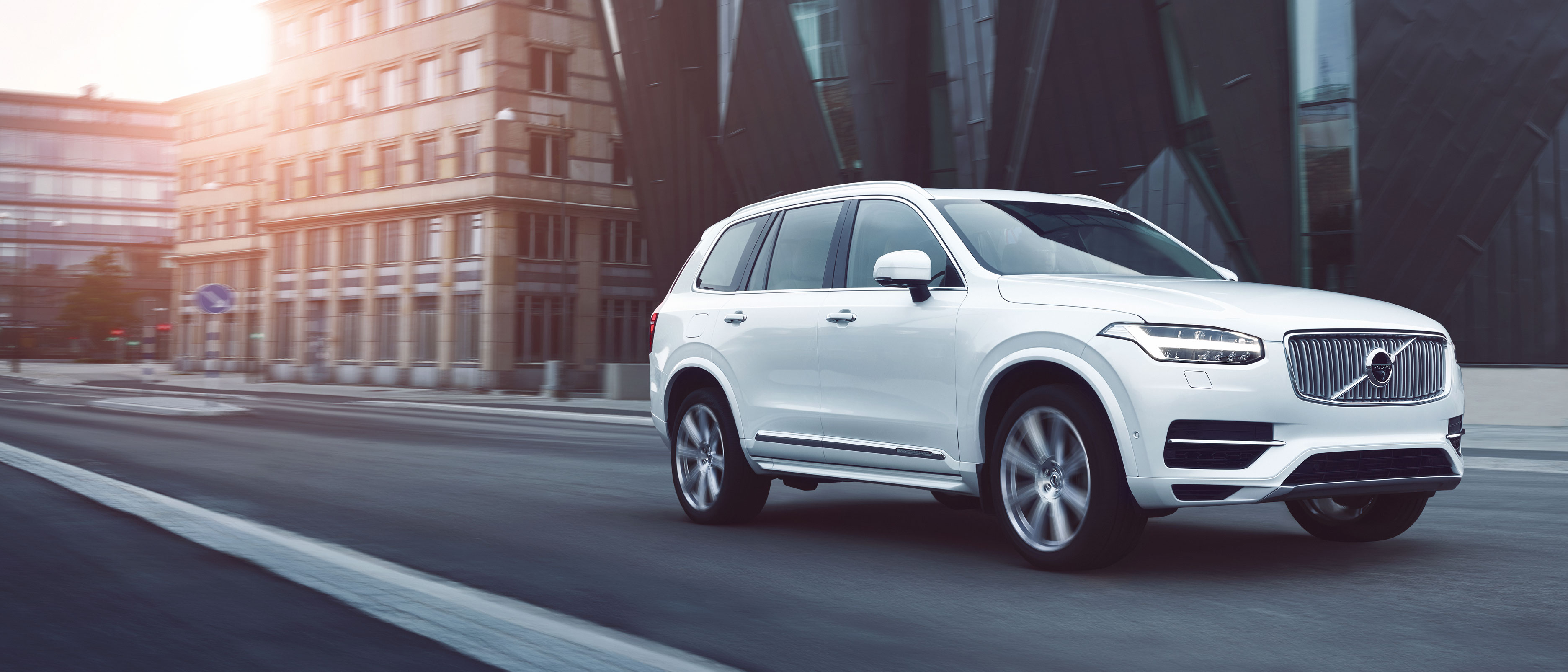 The Volvo XC90 driving down a city road