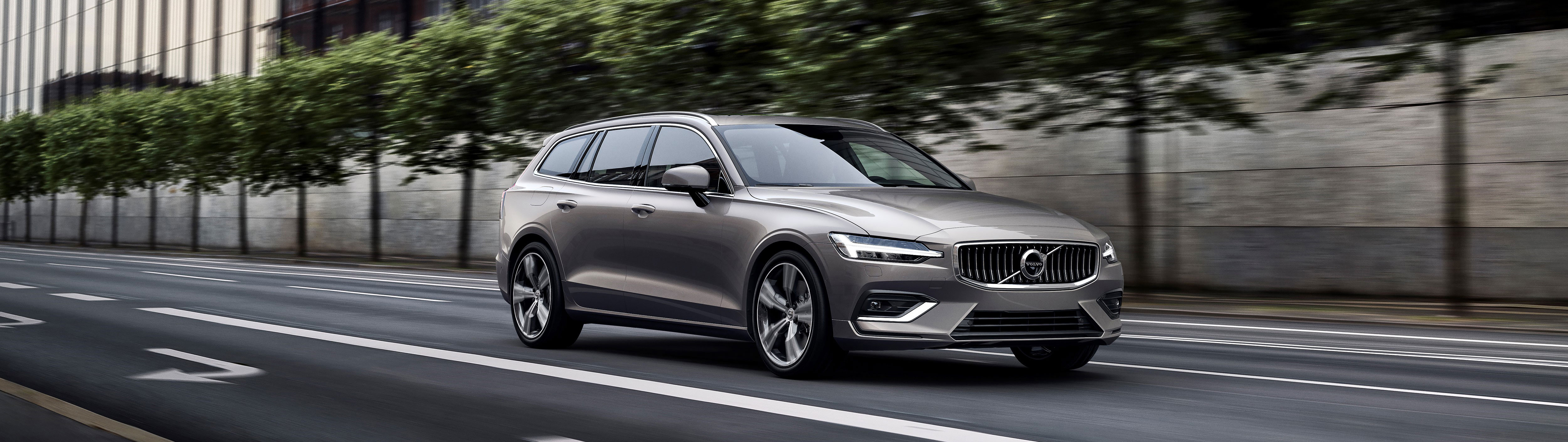 The Volvo V60 while driving on the road.