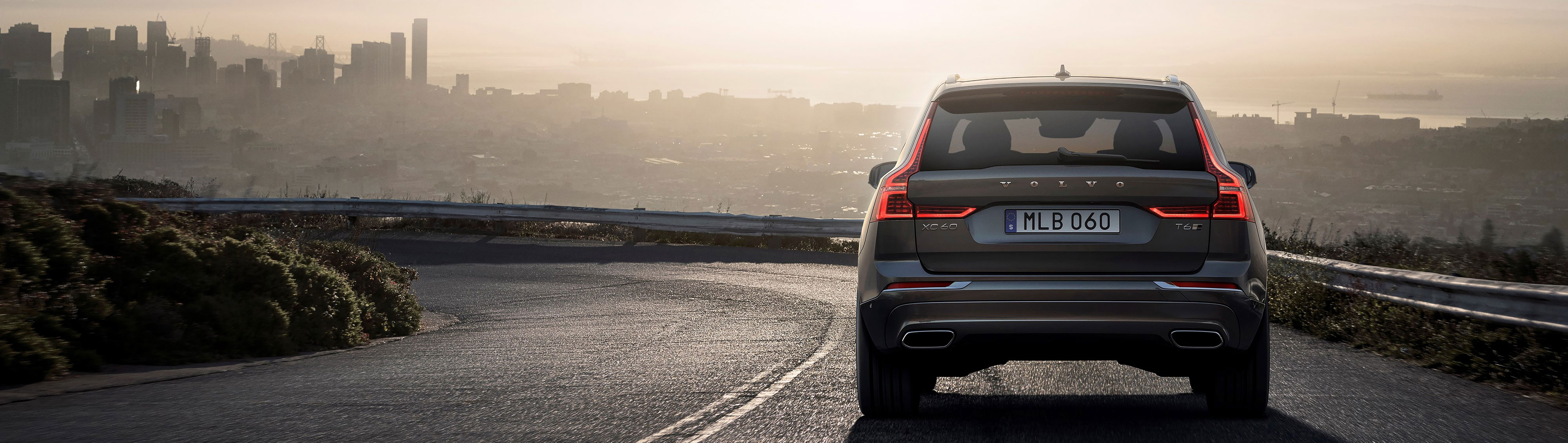Photo of the back of the Volvo XC60 on a curving road
